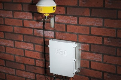 Metro-GPS product on a building wall