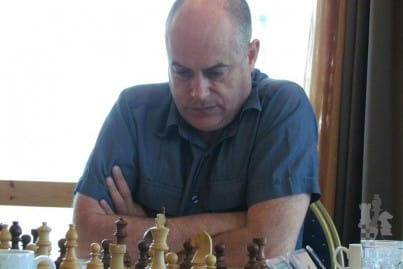 Grand Master Keith Arkell in action - Keith concentrating, playing chess
