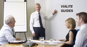 Group shown in learning environment, ViaLite Guides is written on a white board